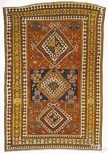Kazak carpet, ca. 1880, with a rust field, 3 centr