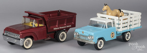 Two pressed steel trucks