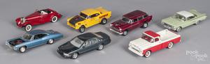 Twelve plastic built model cars