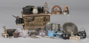 Child's cast iron stove and kitchen accessories