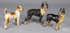 Three cast iron dog doorstops