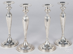 Set of four weighted sterling silver candlesticks