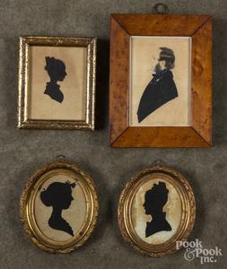 Three female hollowcut silhouettes