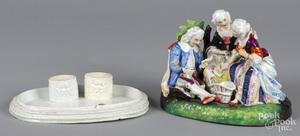 Porcelain lift up figural group