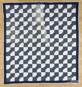 Two contemporary pieced quilts.