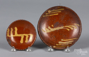Two small slip decorated redware plates