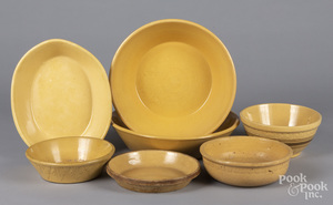 Seven yelloware bowls and serving dishes