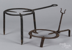 Two wrought iron trivets