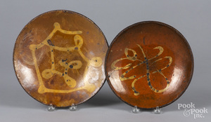 Two New England slip decorated redware plates