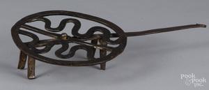 Wrought iron revolving pot rest