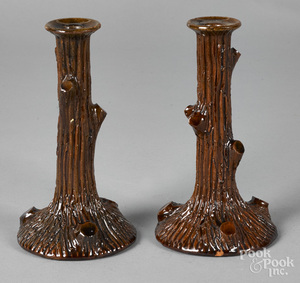 Pair of redware tree trunk candlesticks