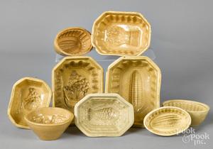 Nine yellowware food molds