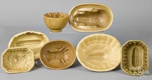 Seven yellowware food molds