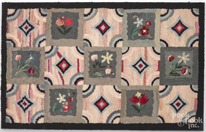 Geometric and floral hooked rug