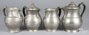Four pewter pitchers