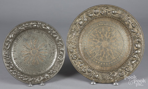 Two Italian embossed pewter chargers