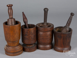 Four walnut and burl mortar and pestles
