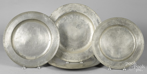 Four English pewter chargers