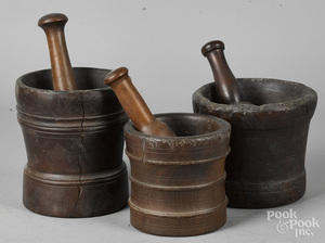 Three lignum vitae mortar and pestles