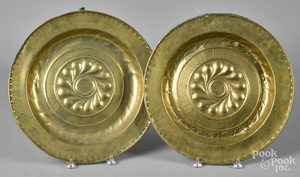 Two embossed brass alms dishes