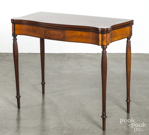 New England mahogany serpentine front card table