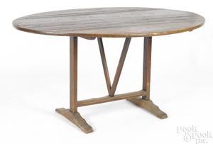 Pine, oak and walnut shoe foot tuckaway table