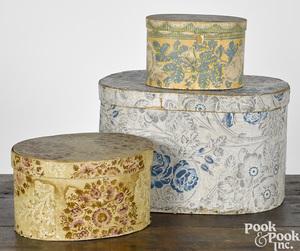 Three wallpaper hat boxes
