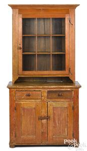 Diminutive pine two-part stepback cupboard