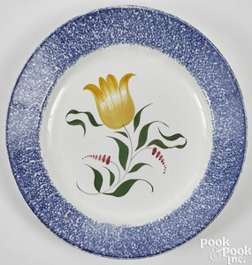 Blue spatter plate with yellow tulip