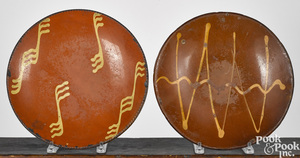 Two Pennsylvania slip decorated redware plates