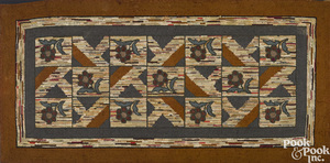 Geometric and floral shirred hooked rug