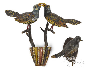 Two painted bird carvings