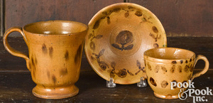 Philadelphia redware cup and saucer