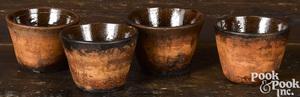 Set of four redware custard cups