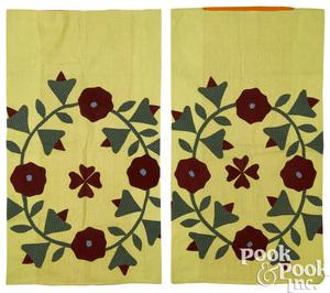 Pair of appliqué floral wreath pillow shams