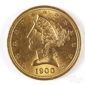 1900 five dollar Liberty head gold coin.