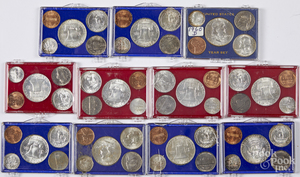 Eleven pre-1964 US coin year sets.