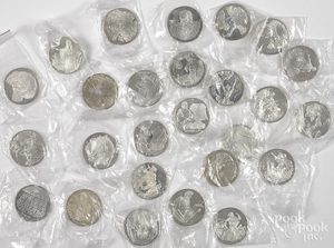 Two sets of thirteen sterling silver coins.