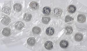 Twenty 1964 Canada silver dollars.