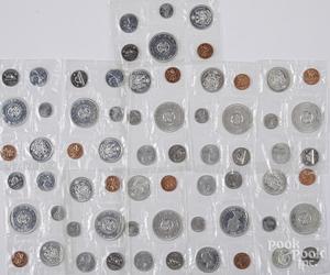 Eleven 1964 Canada mint sets.