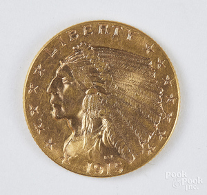 1915 two and a half dollar Indian head gold coin.