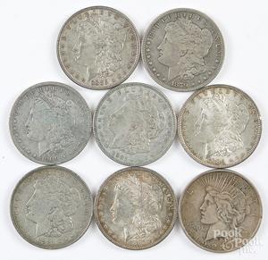 Seven Morgan silver dollars, etc.