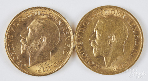 Two George V gold sovereigns.