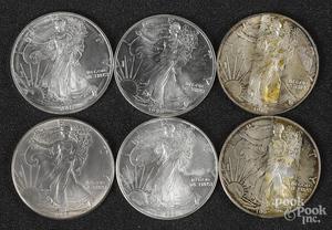 Eighteen American Eagle 1 ozt. fine silver coins.