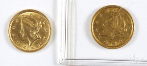 Two US one dollar Liberty head gold coins.