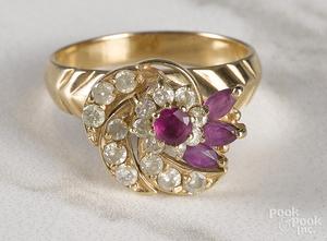 14K yellow gold diamond and gemstone ring.