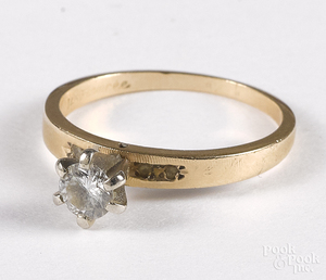 14K gold diamond solitaire ring.