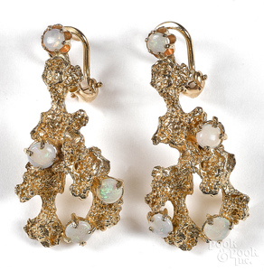 Pair of 14K yellow gold and opal earrings.