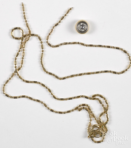14K yellow gold necklace with diamond pendant.