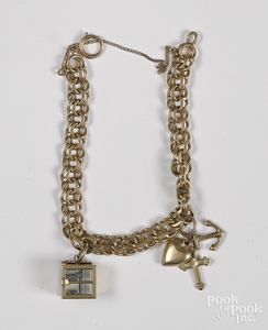 14K yellow gold charm bracelet, 17.2 dwt.